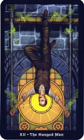 Ý nghĩa lá XII - The Hanged Man trong bộ Steampunk Tarot